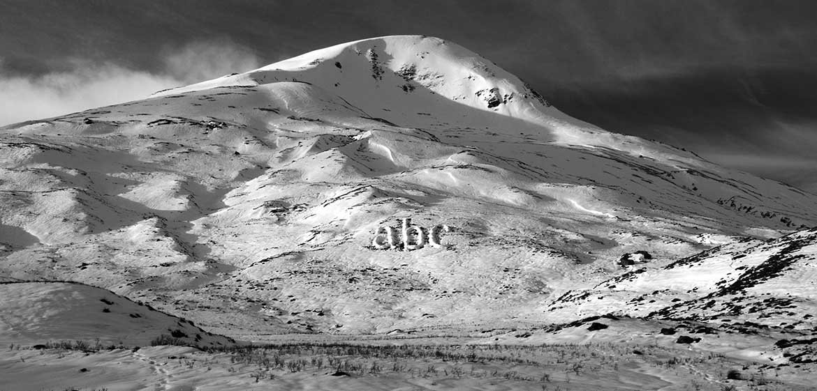 Link to Melt project by Michael Cross. Image shows the letters ABC made of piled up snow on a hillside